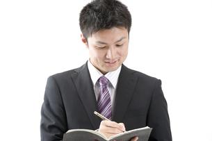 メモをとるビジネスマン FYI00460031