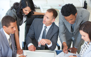 Business team working together in a business plan FYI00482114
