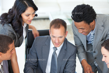 Manager working with Business team in office FYI00482118