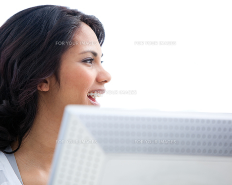 Portrait of a businesswoman working at a computer FYI00482155