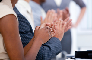 Ambitious business team applauding in a meeting FYI00482302