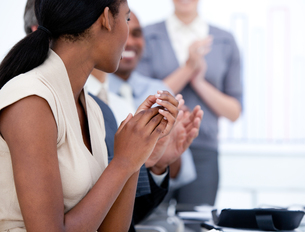 Happy business team applauding in a meeting FYI00482307