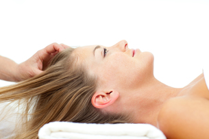 Attractive woman enjoying a head massage FYI00482542