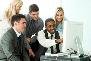 Businessman explaining a job to his team in office FYI00482662