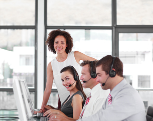 Female leader managing her team in a call center FYI00482796