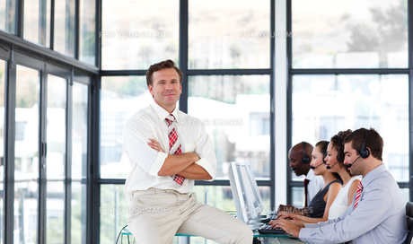 Mature manager with folded arms in a call center FYI00482804