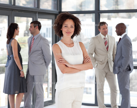 Serious female leader with her team FYI00482809