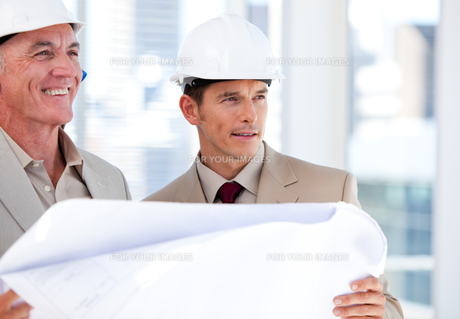 Architects partners looking at the building FYI00482873