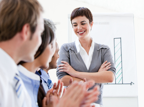 Happy business people applauding a good presentation FYI00482878