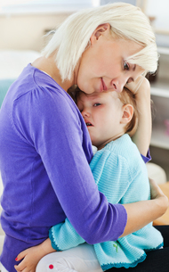 Blond woman taking care of her child FYI00483151