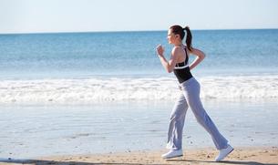 Beautifull woman running on the beach FYI00483209