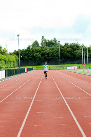 Athletic male sprinter training FYI00483260