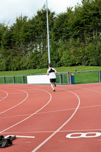 Sporty male sprinter training FYI00483262