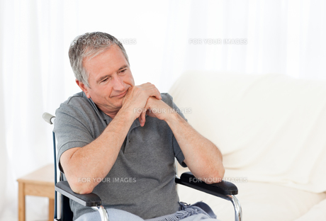 Retired man in his wheelchair FYI00483478