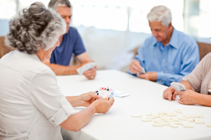 Retired people playing cards together FYI00483699