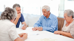 Retired people playing cards together FYI00483702
