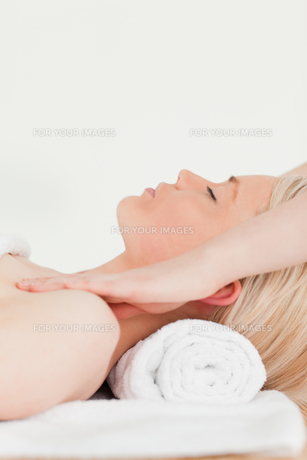Attractive blonde woman enjoying her treatment in a Spa centre FYI00484307