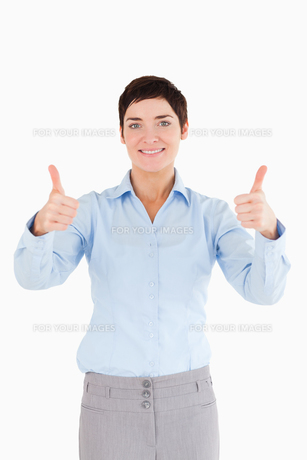 Businesswoman with the thumbs up FYI00484656