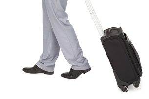 Businessman legs walking with a suitcase FYI00485363