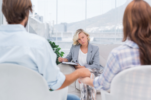 Therapist listening to couple during a session FYI00485415
