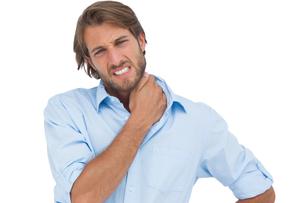 Tanned man having a neck ache FYI00485418