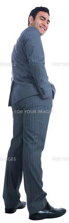 Smiling businessman standing FYI00485773