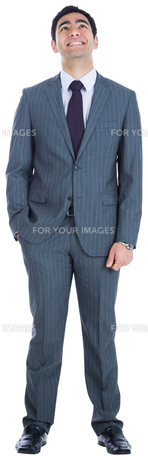 Smiling businessman standing FYI00485774