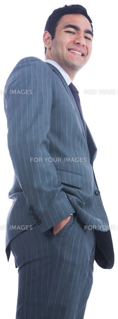 Smiling businessman standing FYI00485779