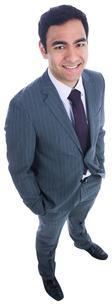 Smiling businessman standing FYI00485780