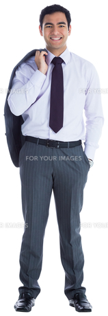 Smiling businessman standing FYI00485781