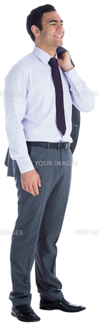 Smiling businessman standing FYI00485792