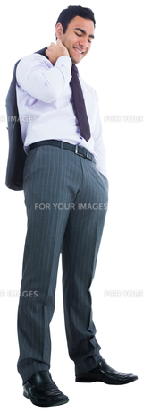 Smiling businessman standing FYI00485801