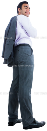 Smiling businessman standing FYI00485806