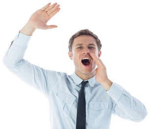 Businessman shouting and waving FYI00485901