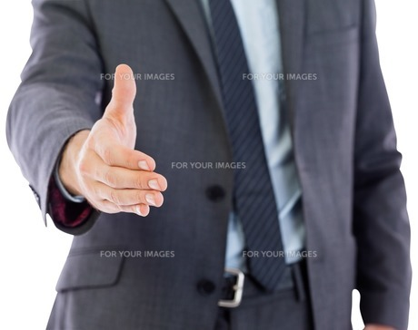 Businessman reaching hand out FYI00485916