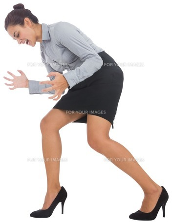 Furious businesswoman gesturing FYI00485944