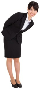 Smiling businesswoman bending FYI00485974