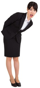 Surprised businesswoman bending FYI00485975