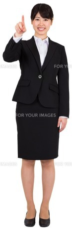 Smiling businesswoman pointing FYI00485976