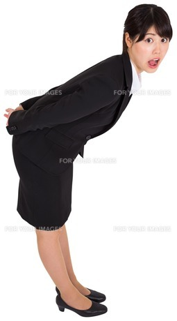 Surprised businesswoman bending FYI00485977