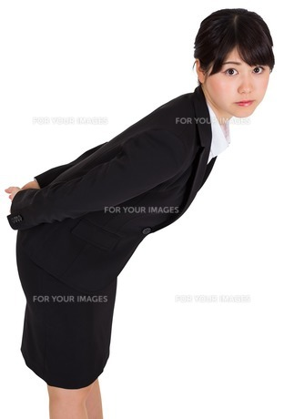 Serious businesswoman bending FYI00485982