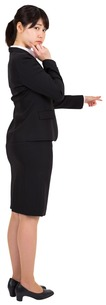 Thoughtful businesswoman pointing FYI00486024