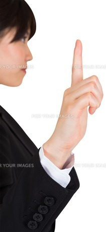 Focused businesswoman pointing FYI00486026