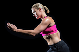 Muscular woman running in sportswear FYI00486079