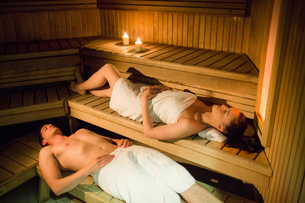 Couple relaxing in the sauna FYI00486142
