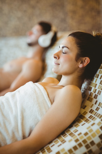 Man wearing headphones and woman lying down together FYI00486354