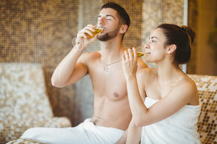 Happy couple drinking theor champagne FYI00486355