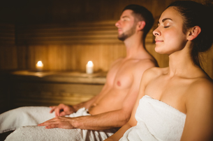 Happy couple enjoying the sauna together FYI00486357
