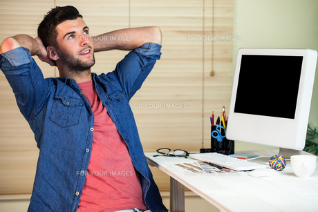 Handsome hipster working at desk FYI00486416
