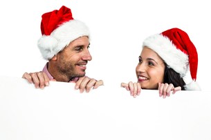Festive couple showing a sign FYI00486505
